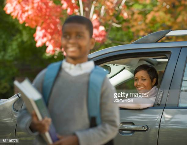 African mother dropping son off at school