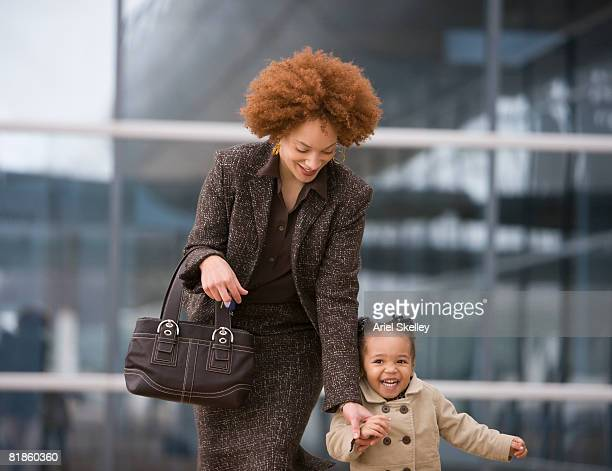 African mother holding daughter?s hand