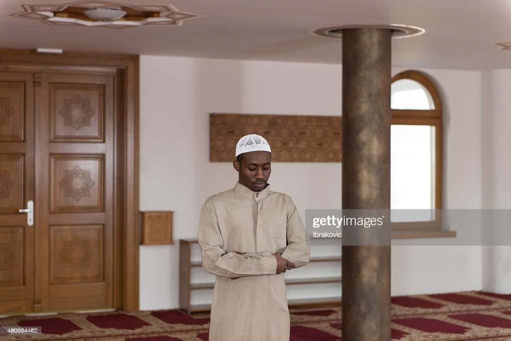 African Muslim Praying In Mosque : Stock Photo