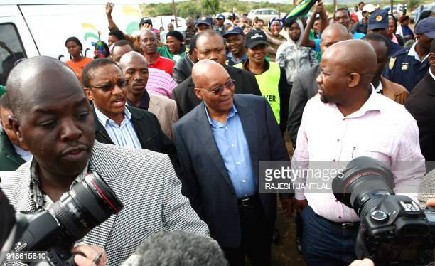 African National Congress leader Jacob Zuma is mobbed by supporters media and security personnel after casting his vote in South Africa's general...