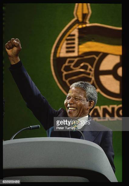 African National Congress leader Nelson Mandela speaks at a rally in Wembley Stadium several months after his release from prison