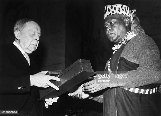 African National Congress President Albert Lutuli receives the 1960 Nobel Peace Prize from Gunnar Jahn, chairman of the Norwegian Nobel Peace Prize...