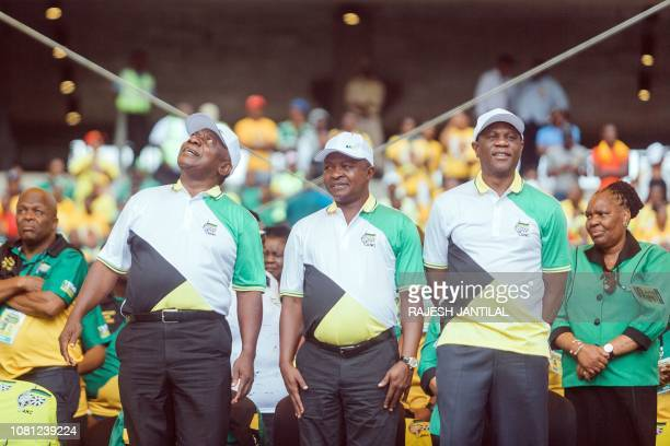 African National Congress President and South Africa President Cyril Ramaphosa motions as he greets thousands of supporters with South Africa Deputy...