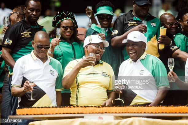 African National Congress President Cyril Ramaphosa toasts with former President Jacob Zuma and Secretary General Ace Magashule during the African...