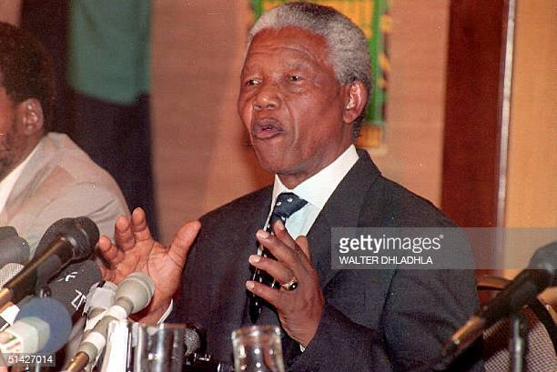 African National Congress President Nelson Mandela addresses a press conference which was delayed because of a bombscare in Johannesburg 31 March...