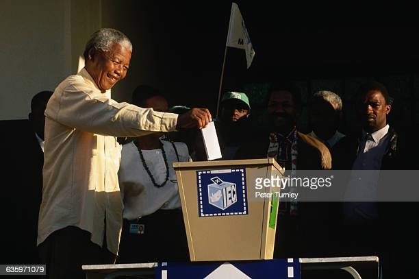 African National Congress presidential candidate Nelson Mandela votes in the first democratic elections in South Africa Mandela the antiapartheid...