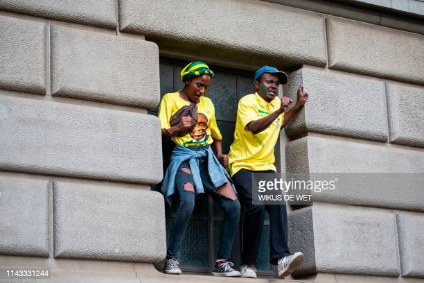 African National Congress supporters dance as they wait for the speech of President Elect of South Africa, outside Lithuli House, the ANC's...