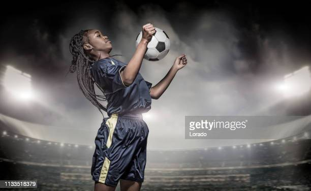 african non-caucasian female football player - soccer competition stock pictures, royalty-free photos & images