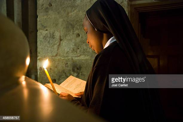 african nun inside jerusalem's holy sepulchre - holy fire jerusalem stock pictures, royalty-free photos & images