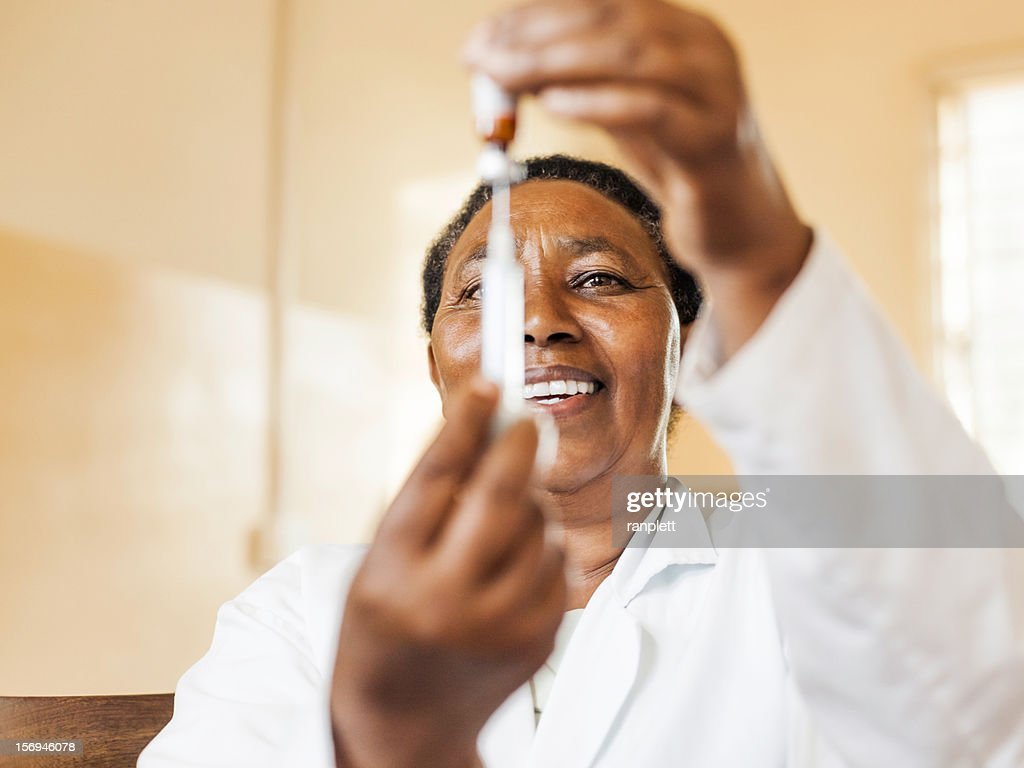 African Nurse with a Vaccine : Stock Photo
