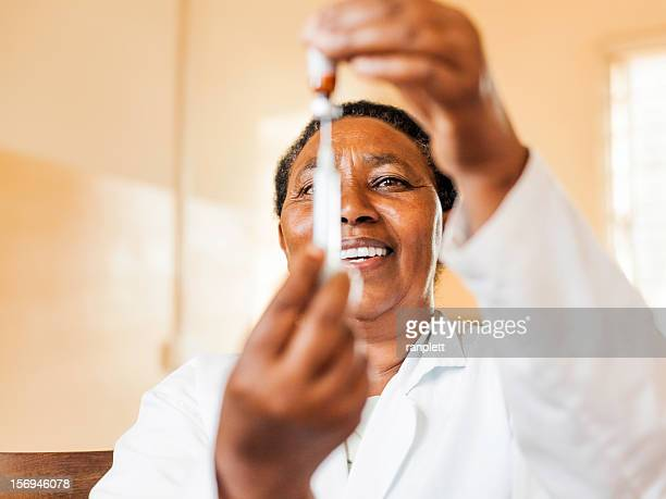 African Nurse with a Vaccine