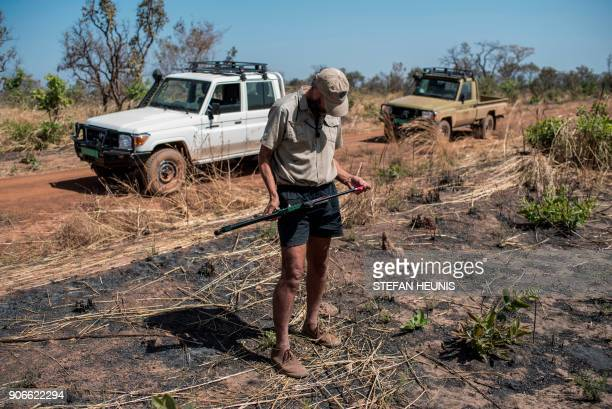 African Parks veterinarian Pete Morkel inspects his equipment before an elephant collaring exercise at Pendjari National Park near Tanguieta on...