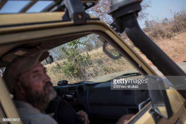 African Parks veterinarian Pete Morkel looks for elephants during an elephant collaring exercise at Pendjari National Park near Tanguieta on January...