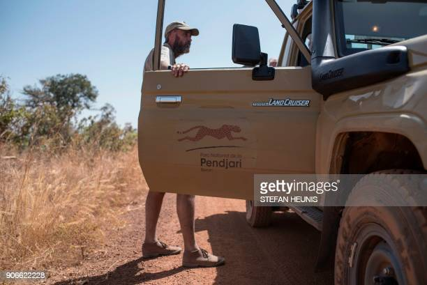 African Parks veterinarian Pete Morkel stands by a vehicle before the start of an elephant collaring exercise at Pendjari National Park near...