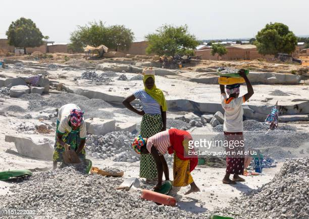 African people working in a granite quarry, Savanes district, Shienlow, Ivory Coast on May 2, 2019 in Shienlow, Ivory Coast.