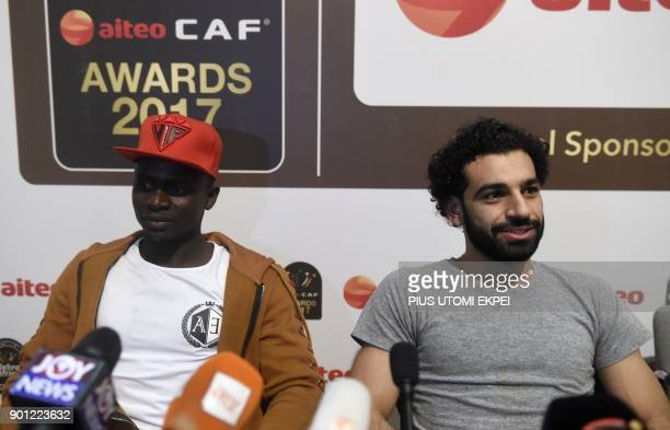African Player of the Year Award nominees Liverpool's Senegalese striker Sadio Mane and Liverpool's Egyptian striker Mohamed Salah attend a media...