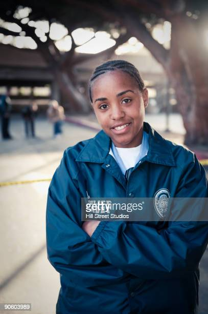 African policewoman smiling with arms crossed
