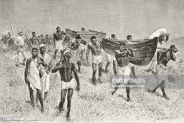 African porters carrying Henry Morton Stanley's dismantled boat Lady Alice on his expedition to explore Lake Victoria From Afrika dets Opdagelse...