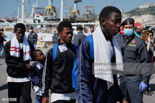 African refugees seen leaving from the ship after being rescued About 1500 african refugees land in Naples from Vos Prudence a rescue boat of...