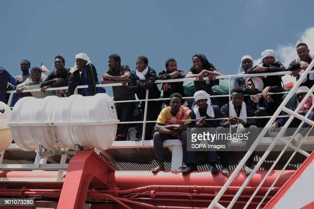 African refugees seen waiting to leave from the ship after being rescued About 1500 african refugees land in Naples from Vos Prudence a rescue boat...