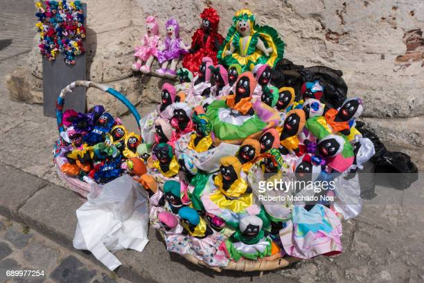 African religion dolls for sale as souvenirs in Old Havana Colorful dolls arranged neatly in baskets for sale on roadside