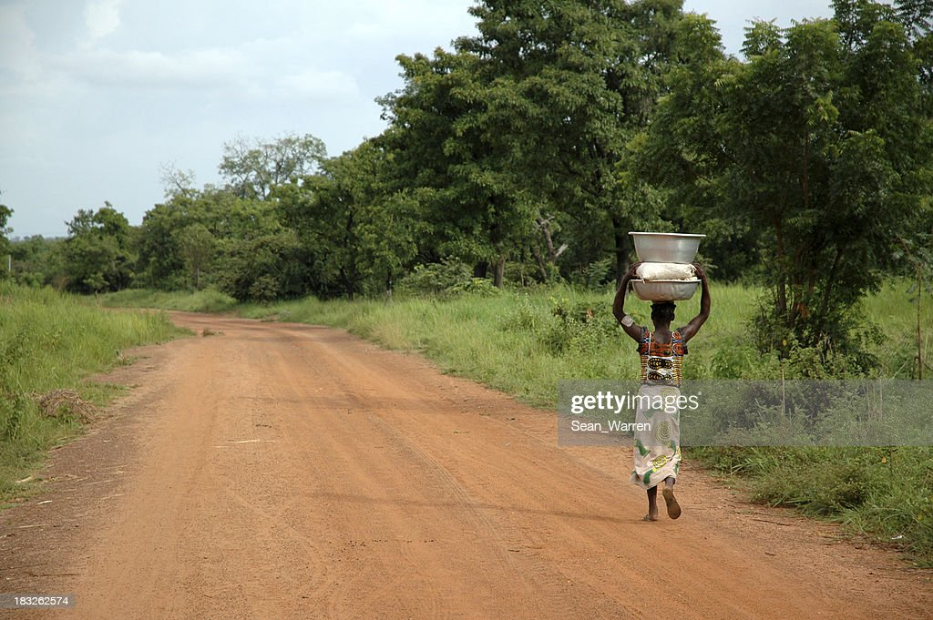 African Road - Woman & Water : Bildbanksbilder