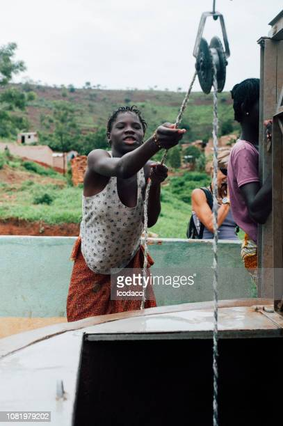 african rudimentary well near bamako - mali stock pictures, royalty-free photos & images