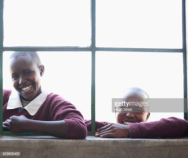 african school girls looking through window - hugh sitton stock pictures, royalty-free photos & images
