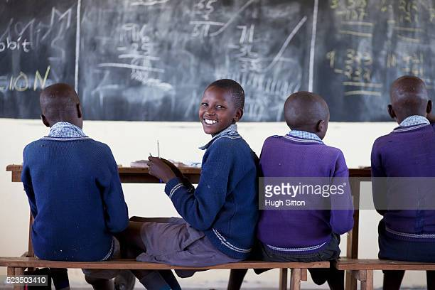 african schoolboys (10-12) sitting in front of blackboard - hugh sitton stock pictures, royalty-free photos & images