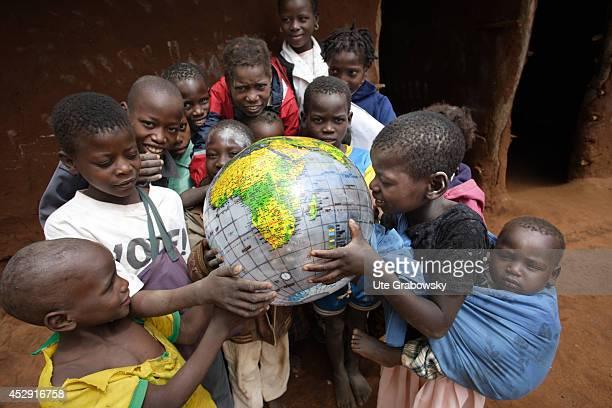 African schoolchildren playing with a globe in the village Vale Shingwedzi on July 02 in Vale Shingwedzi Mozambique The village Vale Shingwedzi is...