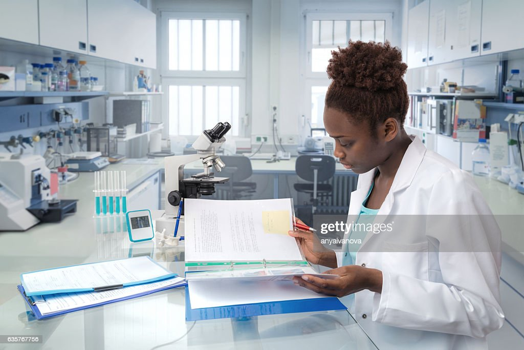 African scientist, medical worker or tech in modern laboratory : Stock Photo