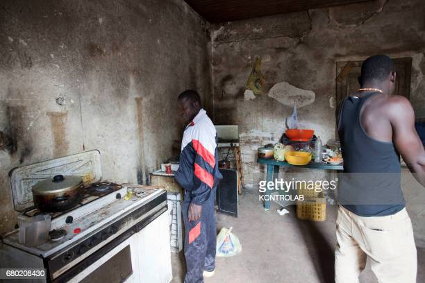 SAN FERDINANDO ROSARNO CALABRIA ITALY African seasonal workers in an abandoned farmhouse where he rent a bed in countyside near Rosarno