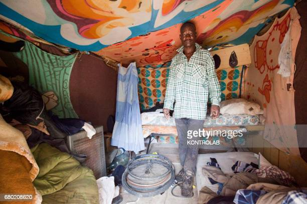 SAN FERDINANDO ROSARNO CALABRIA ITALY African seasonal workers in his makeshift shelter in countyside near Rosarno