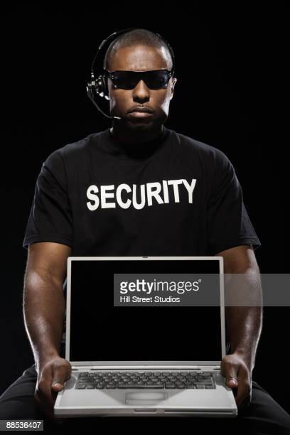 African security guard with laptop
