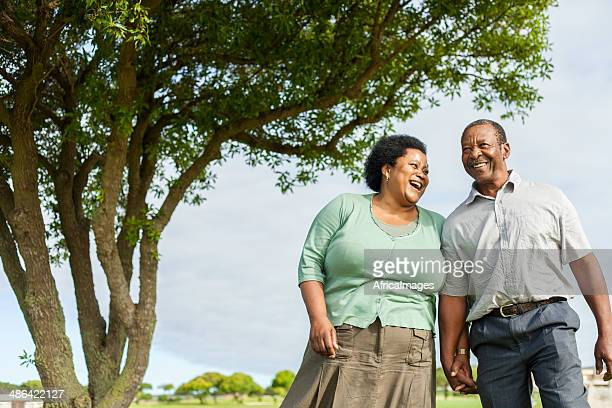 African senior couple laughing, enjoying each others company