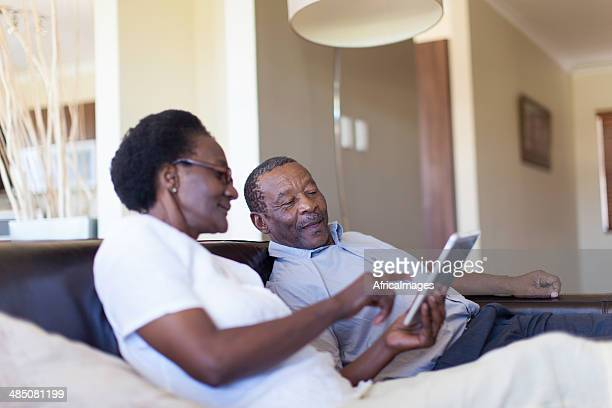 African senior couple working together on a digital tablet