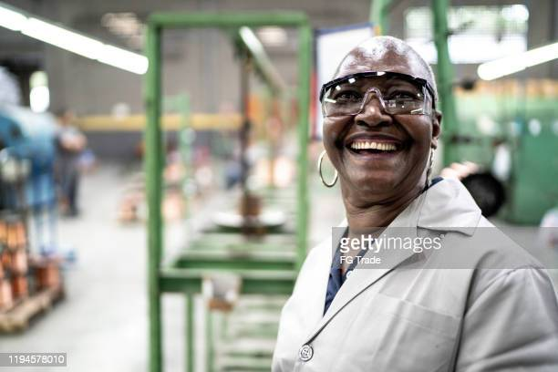 african senior employee portrait at a industry - gender equality stock pictures, royalty-free photos & images