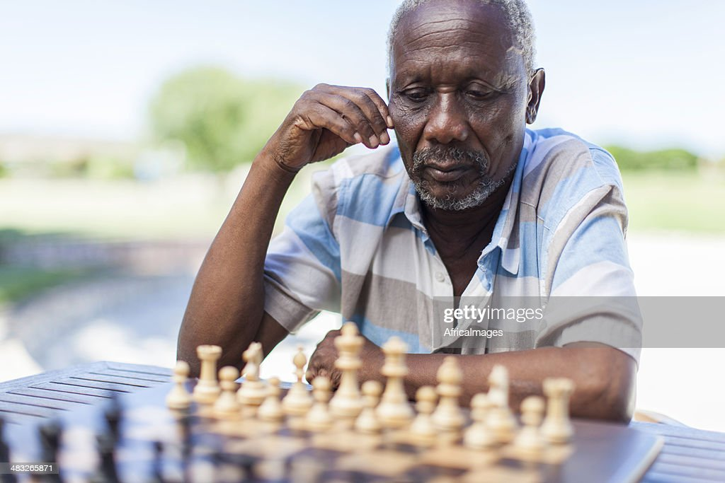 African senior thinking about his next move : Stock Photo