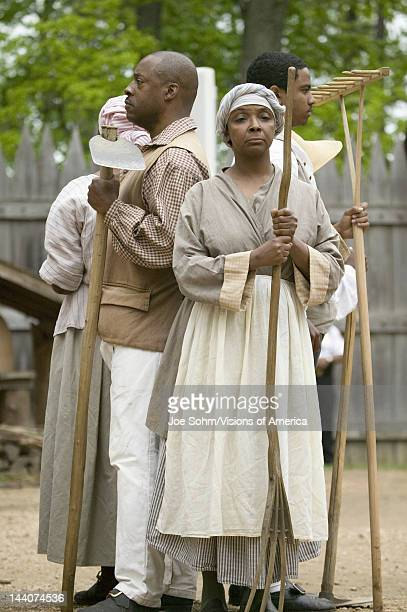 African slave reenactors posing as part of the 400th anniversary of the Jamestown Colony Virginia attended by Her Majesty Queen Elizabeth II at the...