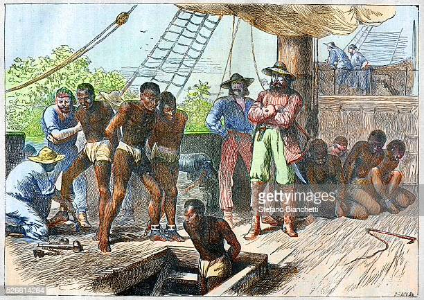 African slaves being taken on board ship bound for USA engraving 1881