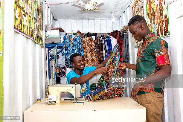 african sole trader tailor at work - ghana africa fotografías e imágenes de stock