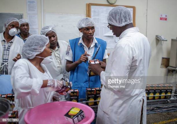 African staff checking bottled tetrapacks with fruit juice in a laboratory Production of juice at beverage manufacturer Kevian Kenya Ltd on May 18...