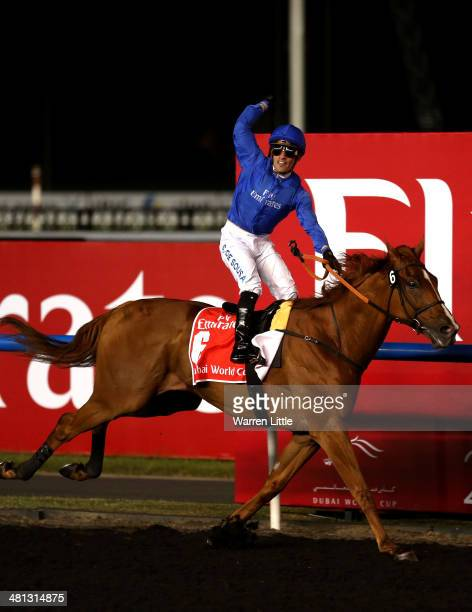 African Story ridden by Silvestre De Sousa wins the Dubai World Cup at the Meydan Racecourse on March 29 2014 in Dubai United Arab Emirates