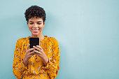 African stylish woman using smart phone