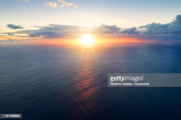 african sunset over indian ocean, aerial view, le morne, mauritius - morning stock pictures, royalty-free photos & images