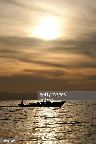 african sunset with boat on lake tanganyika - burundi east africa stock pictures, royalty-free photos & images
