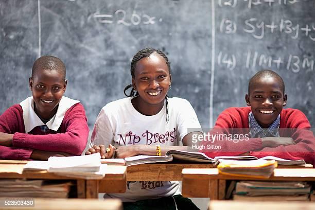 african teacher and students at classroom - hugh sitton bildbanksfoton och bilder