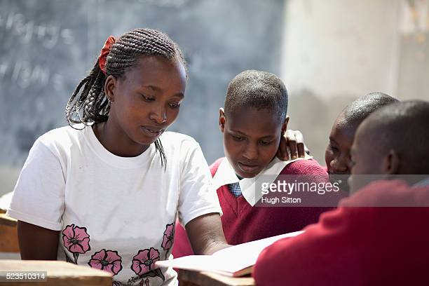 african teacher and students at classroom - hugh sitton stock pictures, royalty-free photos & images