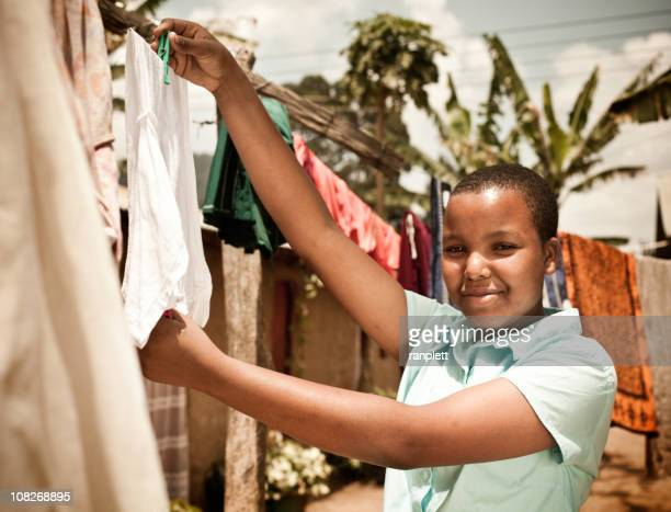 African Teen Hanging Clothes