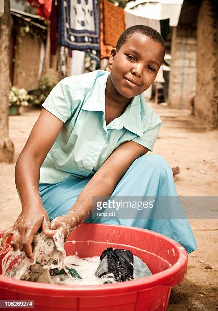 African Teen Washing Clothes